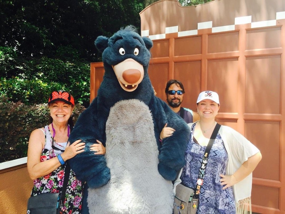 People standing with Baloo from the jungle book