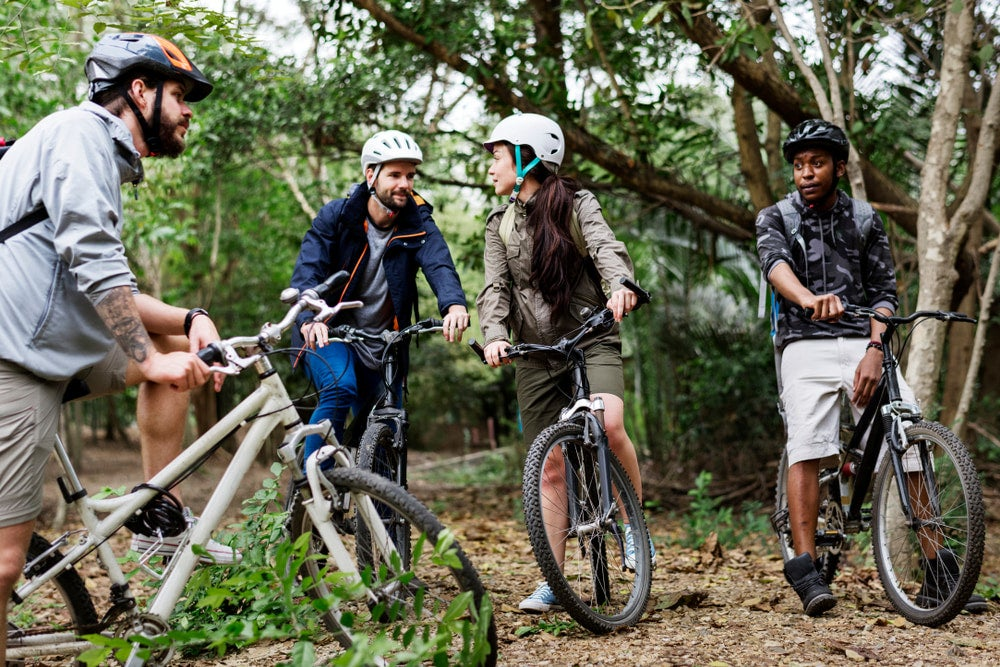 a Group of people taking a break while mountain biking.