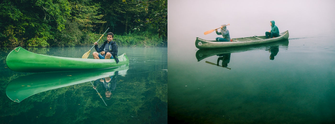 Person paddling alone in a canoe and two people paddling together in a canoe.