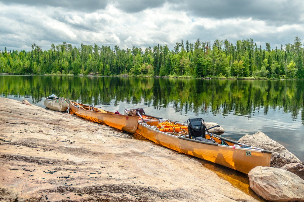 Canoes tied up at waters edge in the Boundary waters.