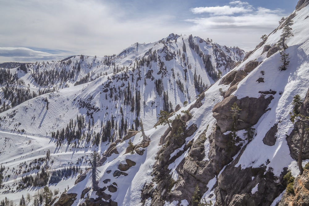 Aerial view of slopes at Squaw Alpine resort during winter in Lake Tahoe.