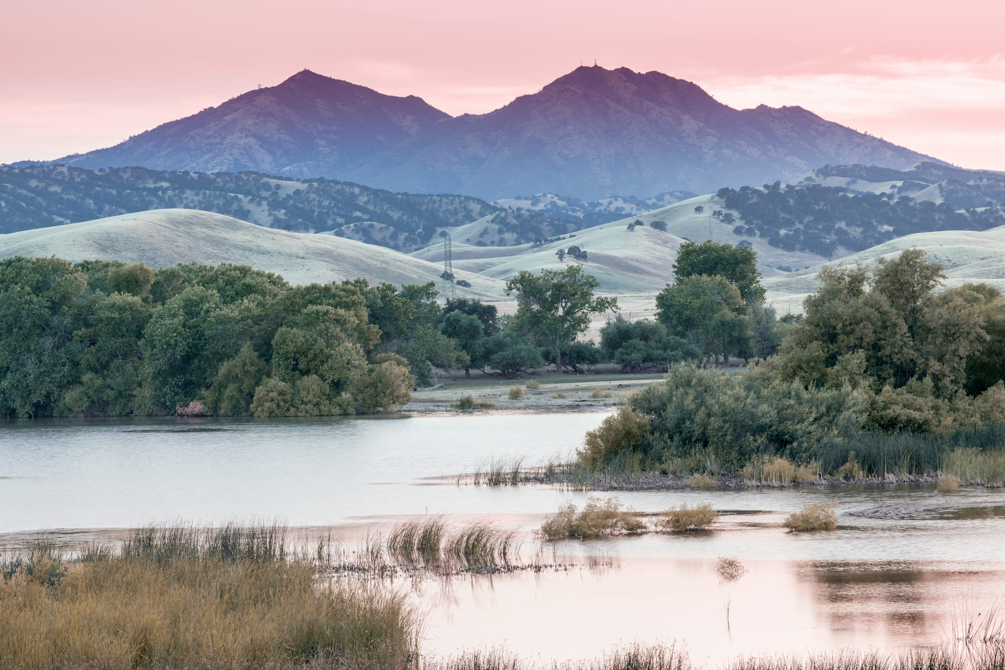Mt. Diablo at sunset from banks of a waterfront