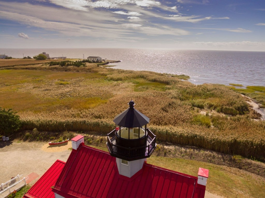 Aerial view of a roof top light house over the coast of Cape May.
