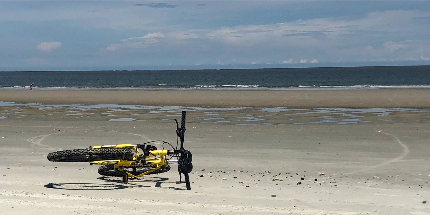 Yellow bike resting on the beach on Hunting Island.
