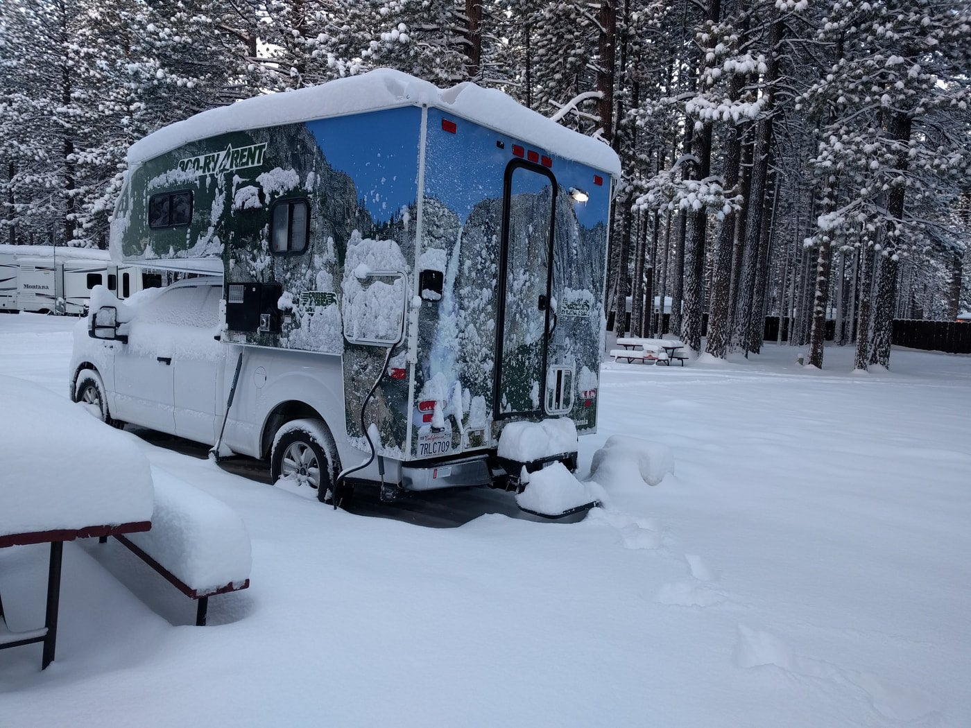 a Snow covered Campervan at Tahoe Valley Campground.