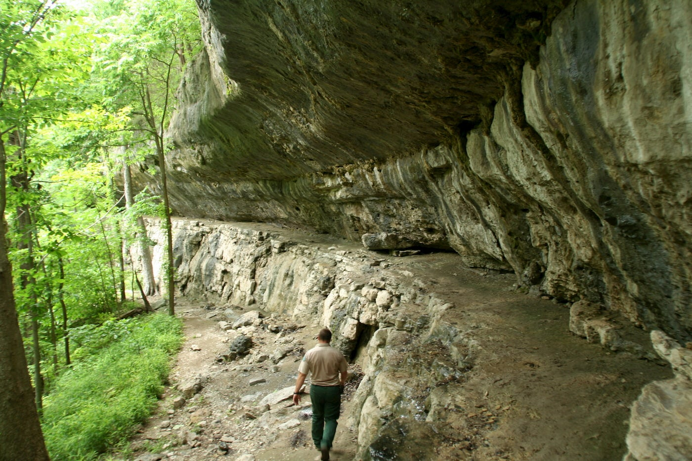 Person walking the Devil's Kitchen cave trail.