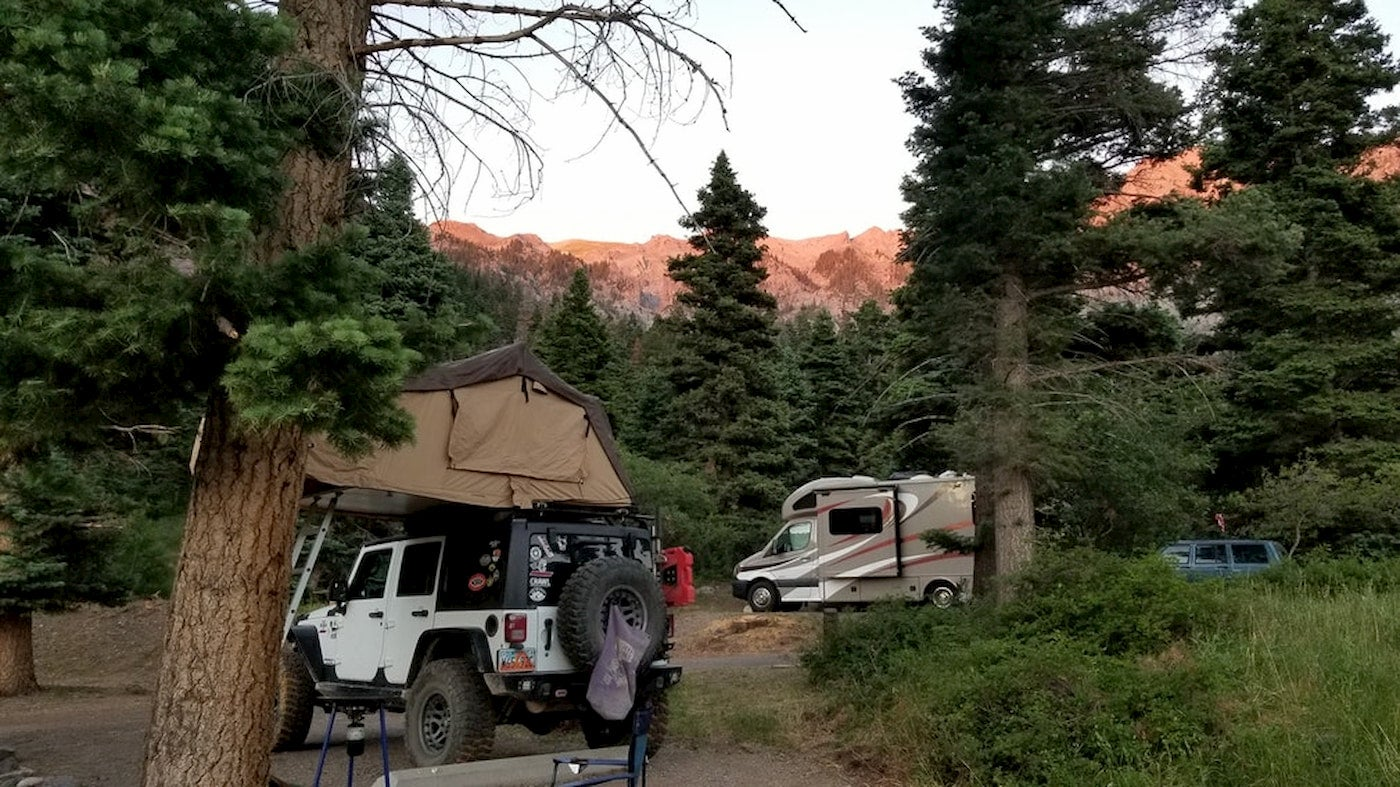 Pop-up tent and RV parked in Amphitheater campground in Ouray.
