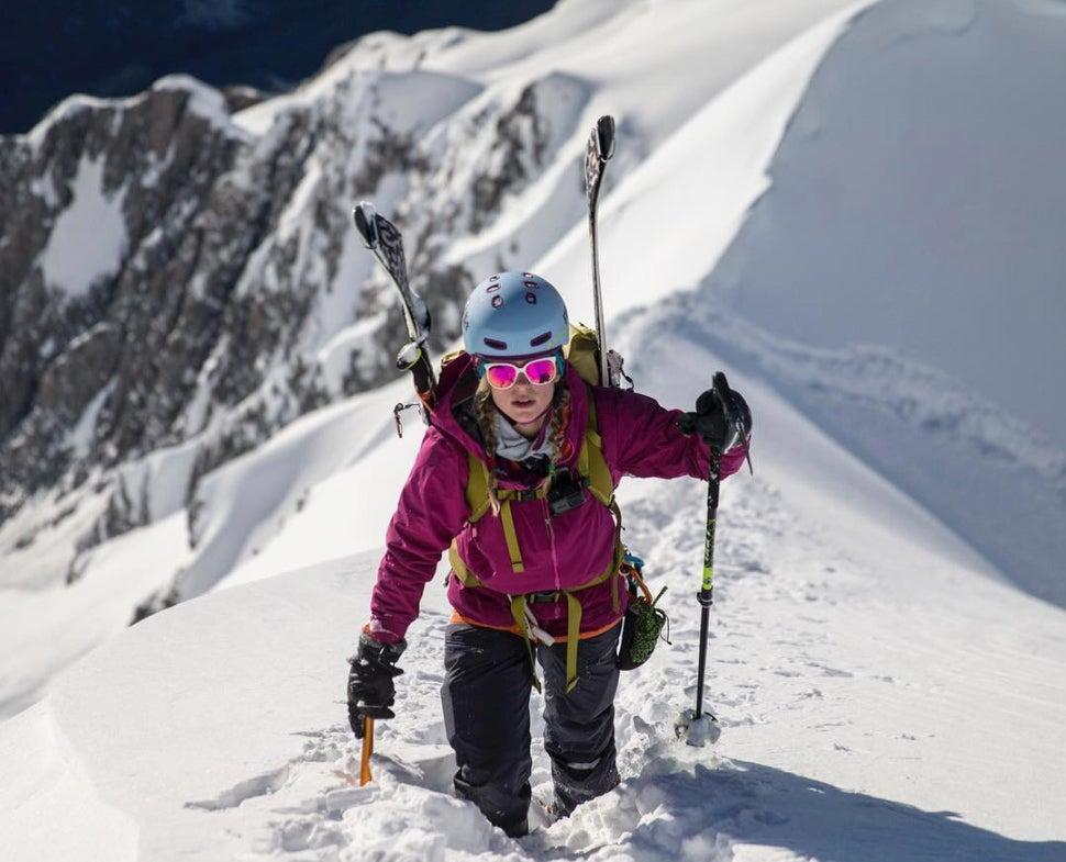 Caroline Gleich climbing a mountain in deep snow