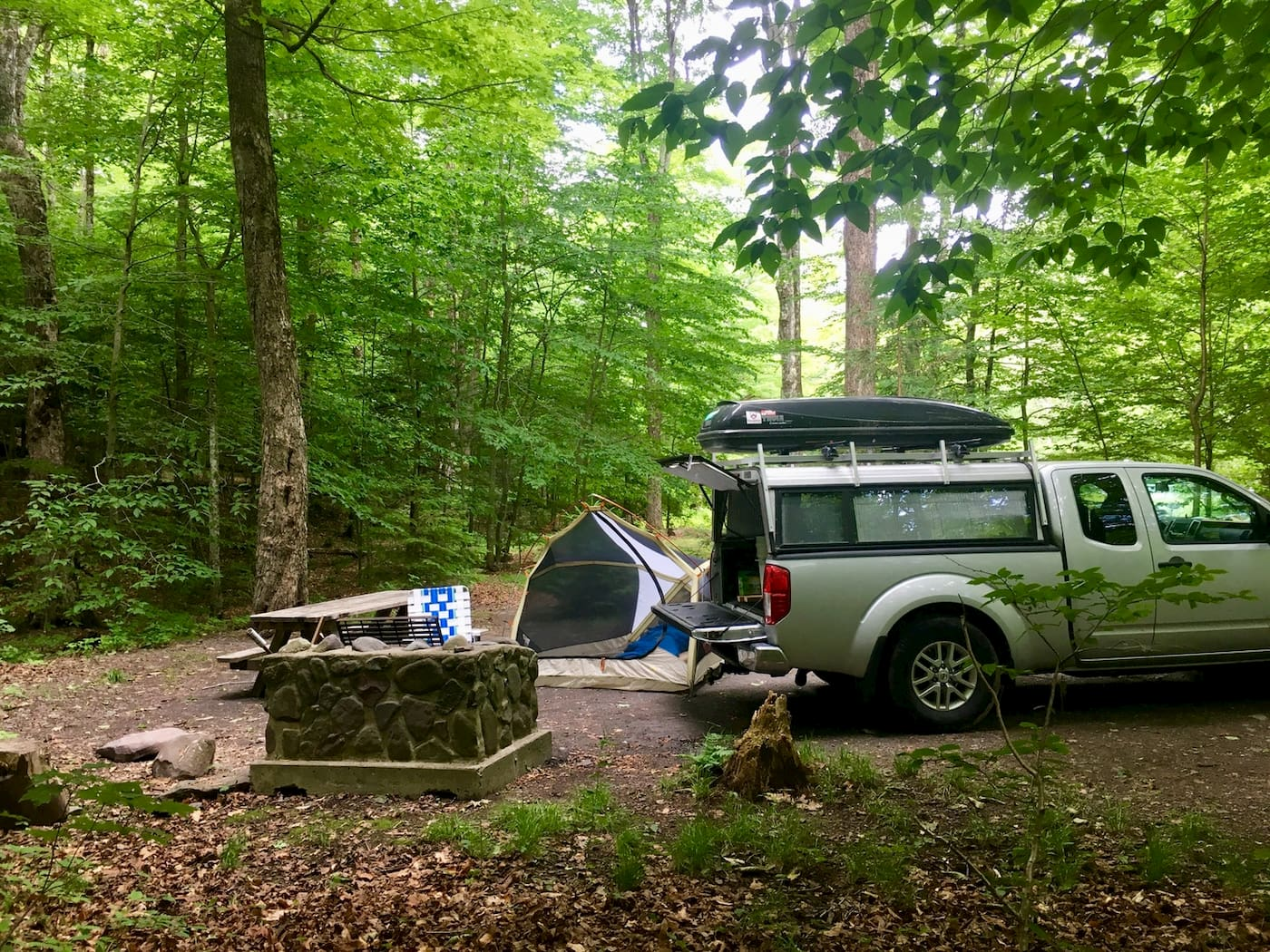 Campsite at Devil's Tombstone with firepit and tent.