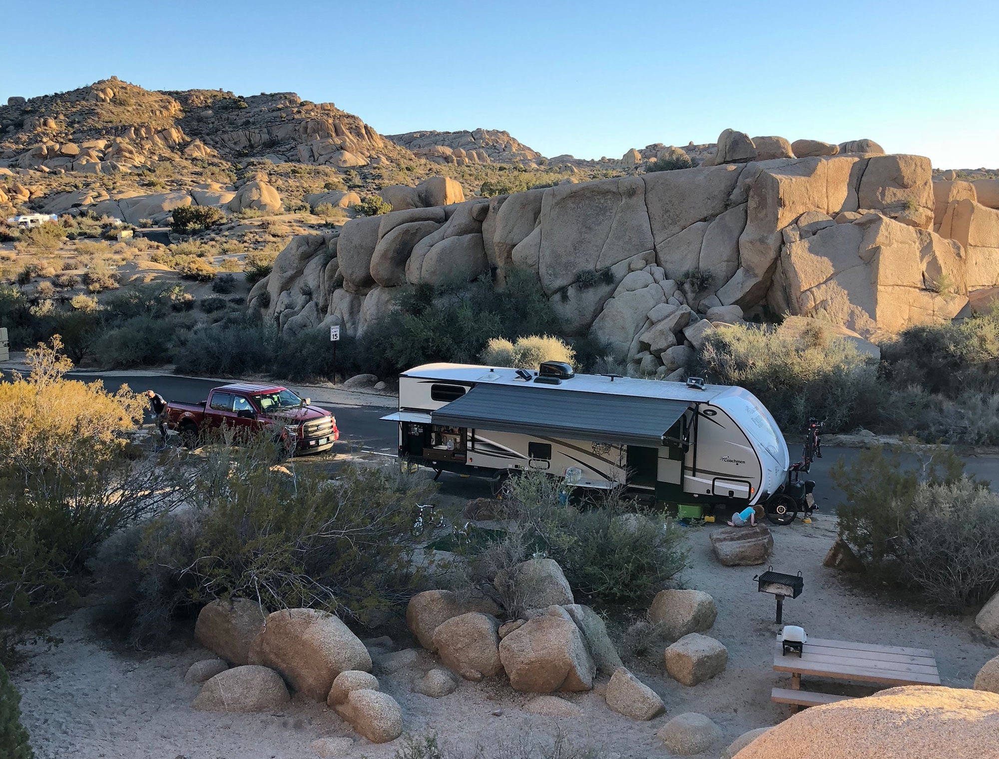 an RV camper parked off a road at jumbo rocks campground in california