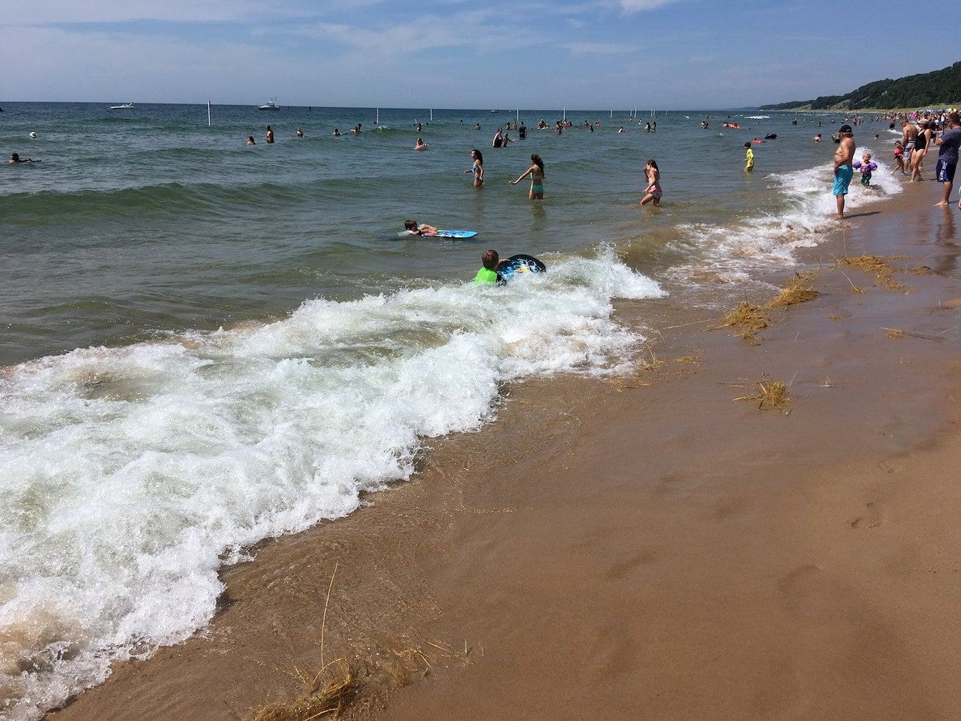 Children playing on the crowded shores of Holland beach.