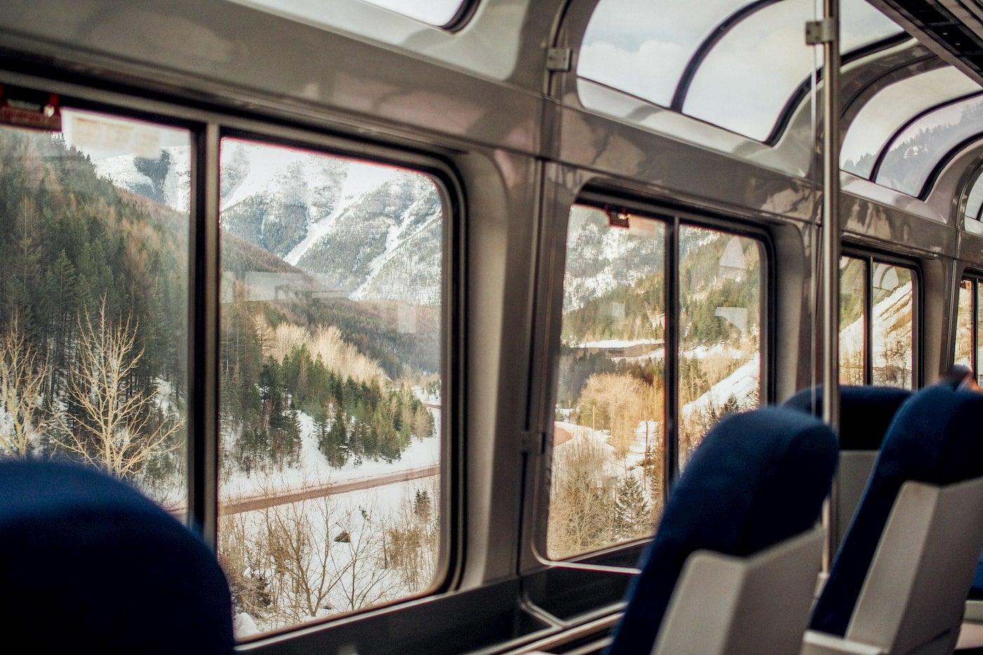 Western alpine landscape from the windows of a AMTRAK train car.