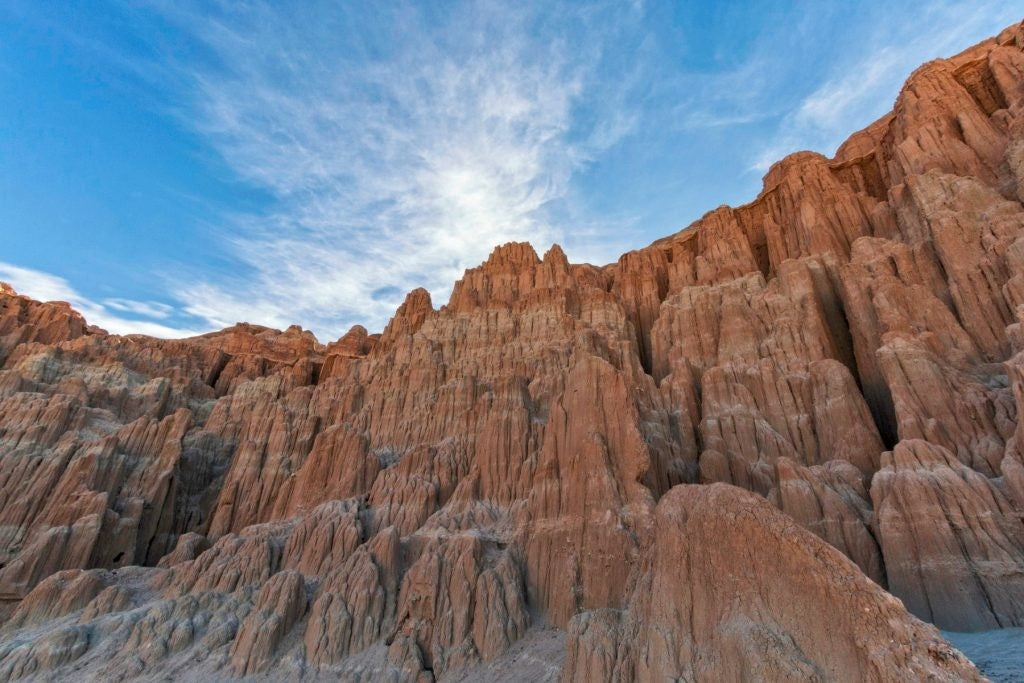 a view of a craggy rock wall at cathedral gorge state park in nevada
