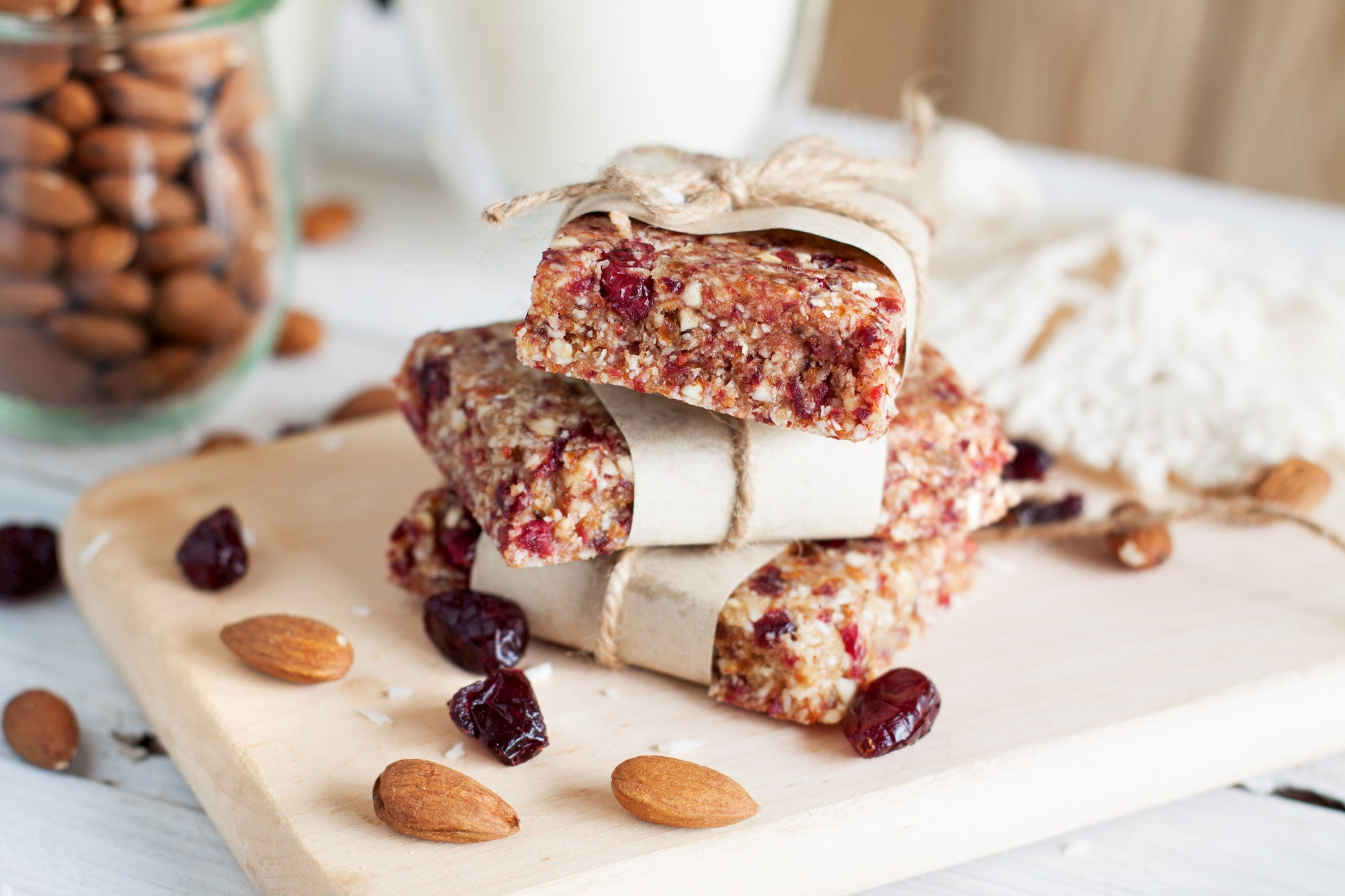 Energy bars stacked on top of one another on a cutting board