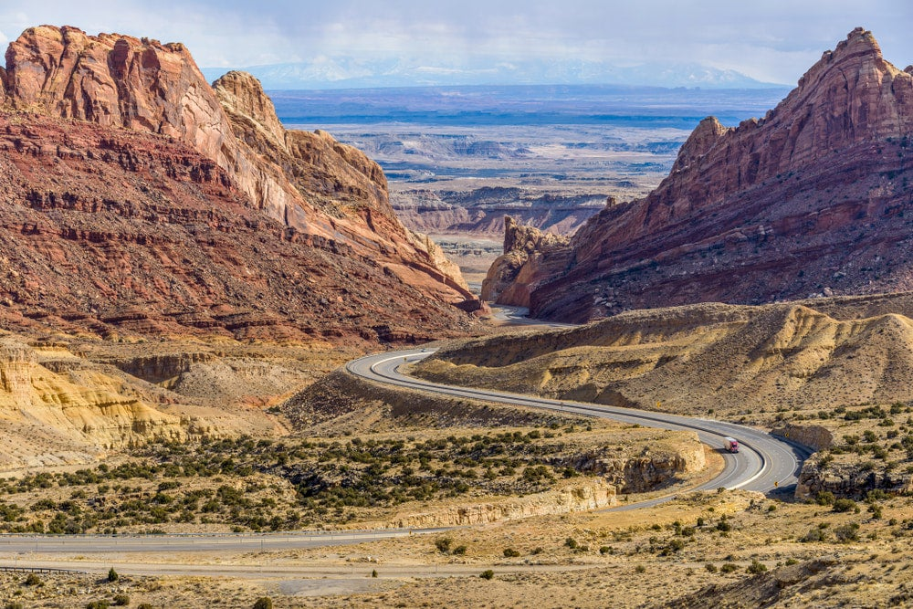Wide angle view of red rocks and road running through red rock canyon