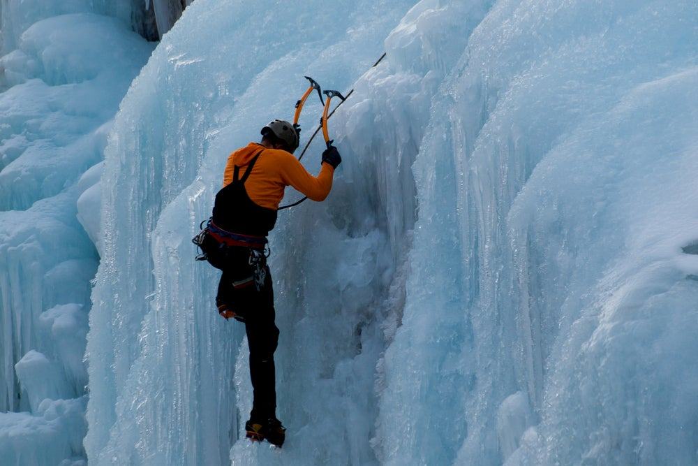 Ice climber climbing in Box Canyon.