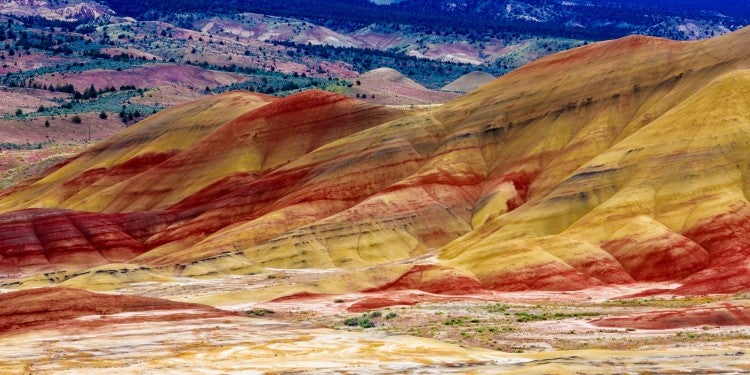 Colorful hills and larger mountains in background