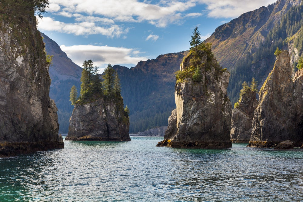 Rock formations jutting out of the water at Kenai Fjords National Park.