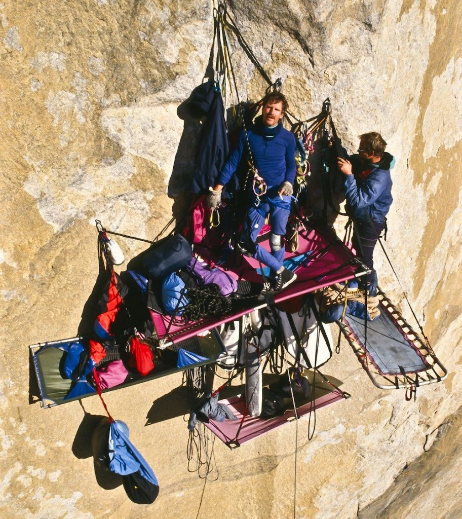 Climbers at their portaledge camp on a large wall.