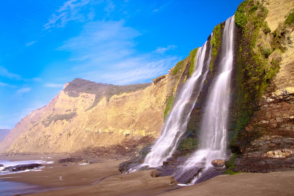 Alamere Falls waterfall dropping directly into the pacific Ocean on california coast