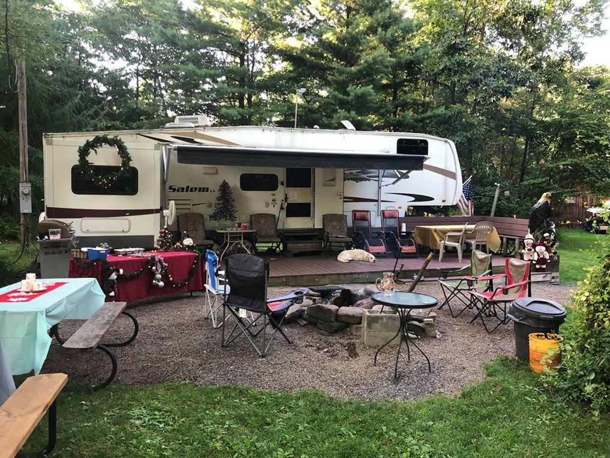 rv campsite with chairs and firepit