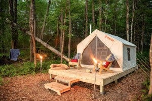 a glamping tent at a campsite in maine at night
