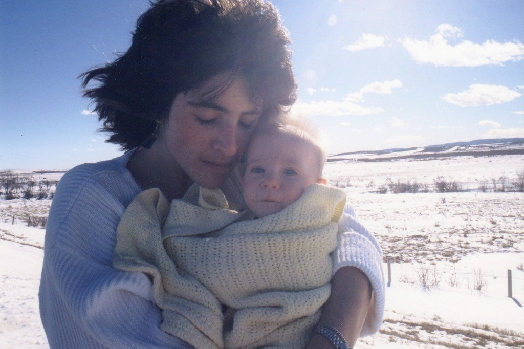image of author jan redford holding her baby outdoors