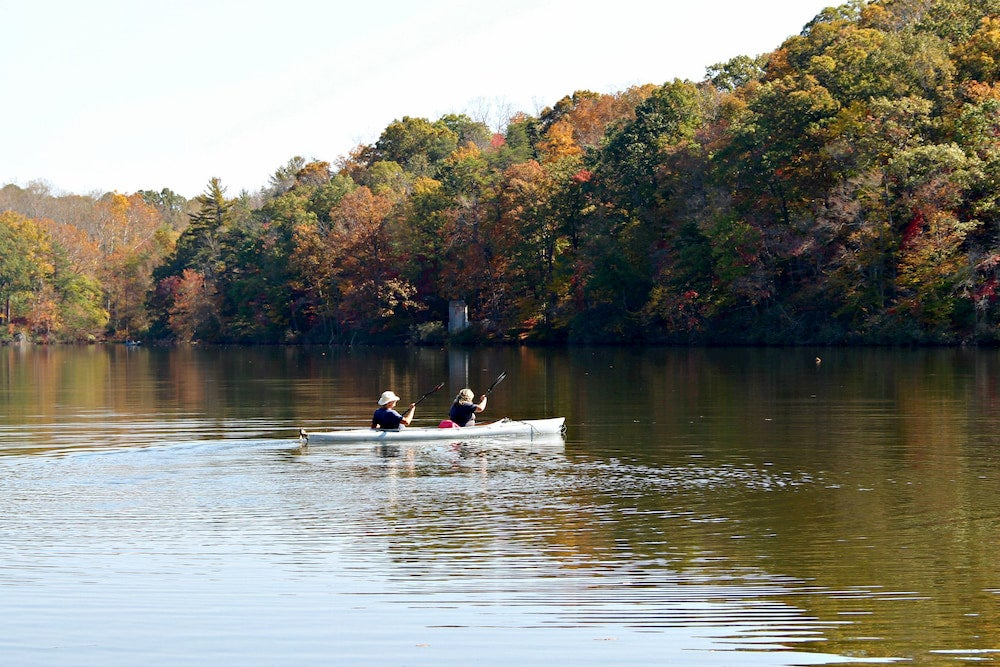 a couple on a paddle boat on fairy stone lake