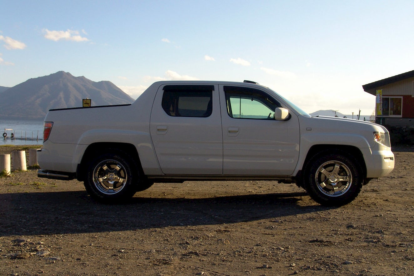 Honda Ridgeline parked in mountain desert landscape.