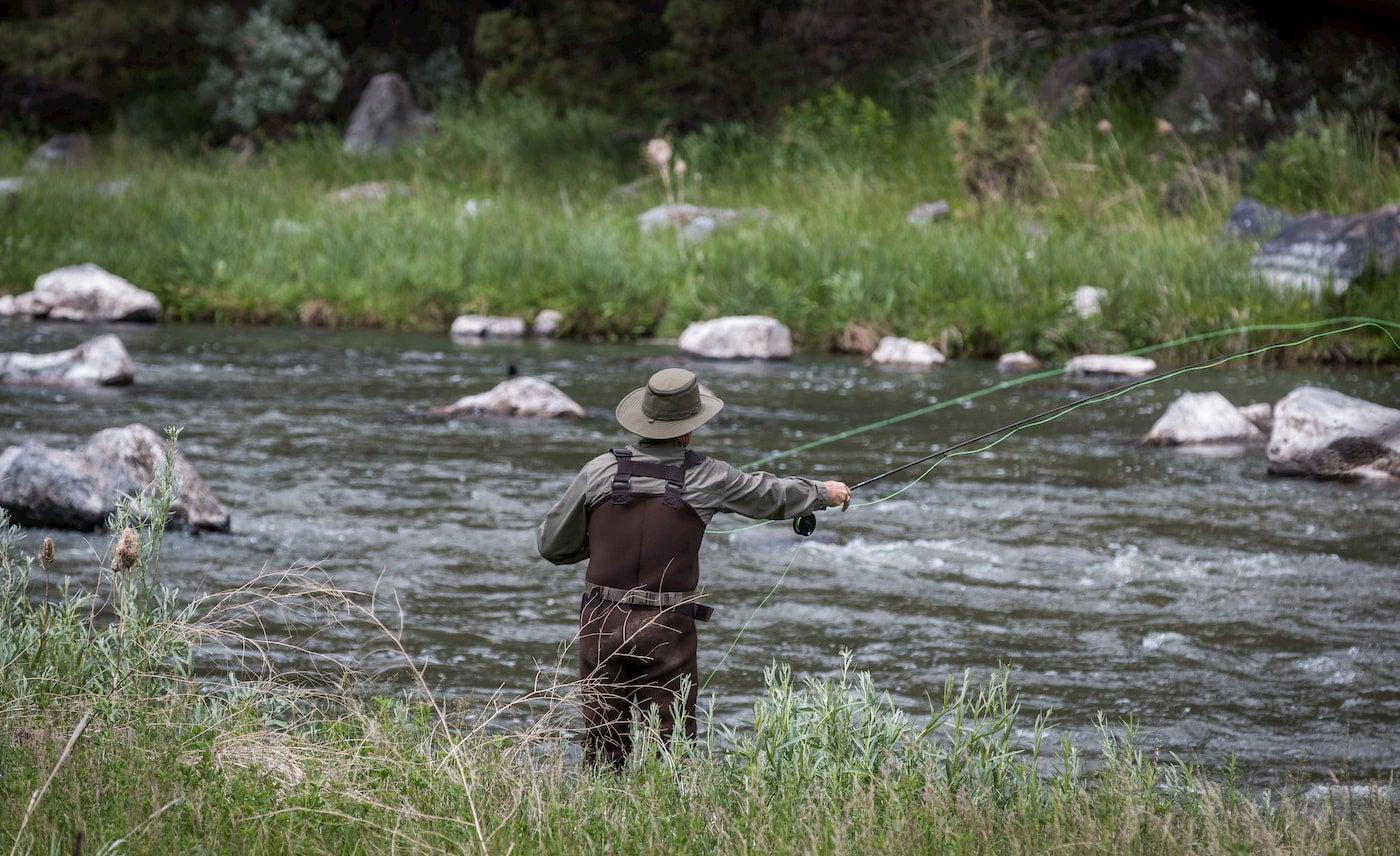 Fly fisherman casting in Sauk River.