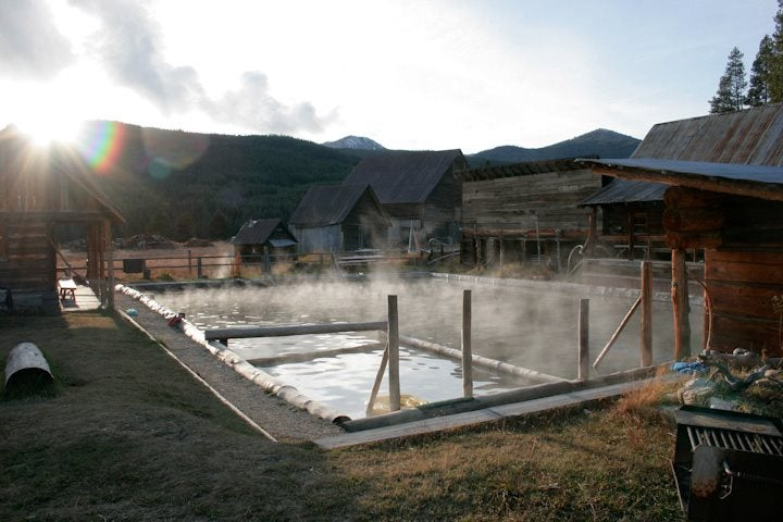 a steamy hot spring at a farm at sunrise
