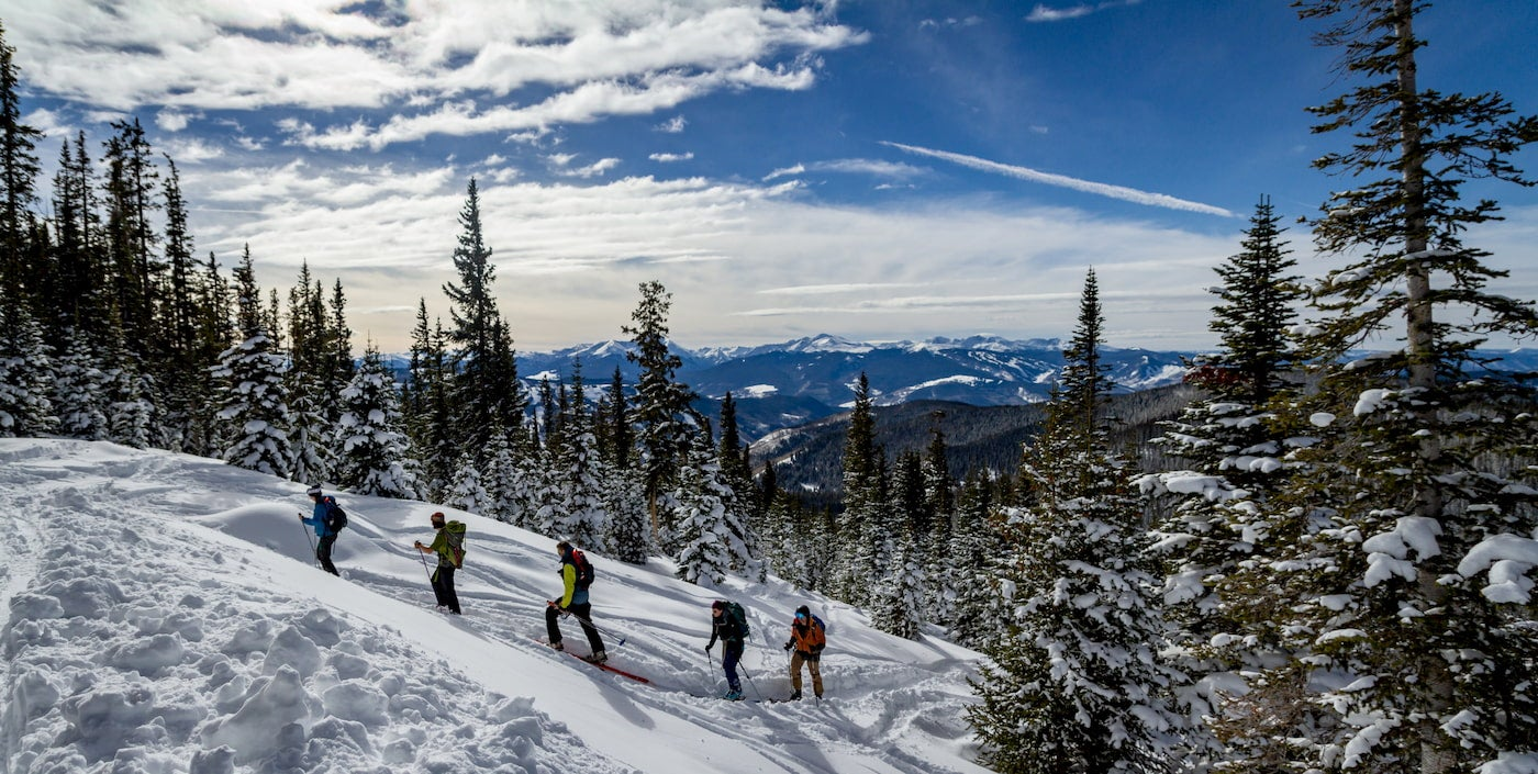 Backcountry skiers hiking uphill.
