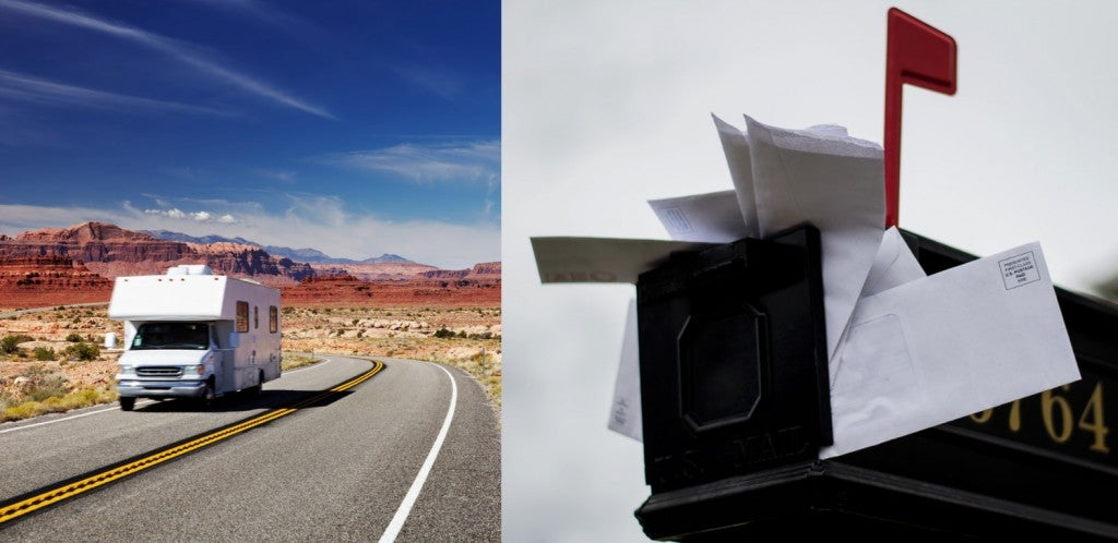 an RV driving through the desert next to a mailbox overfilled with mail
