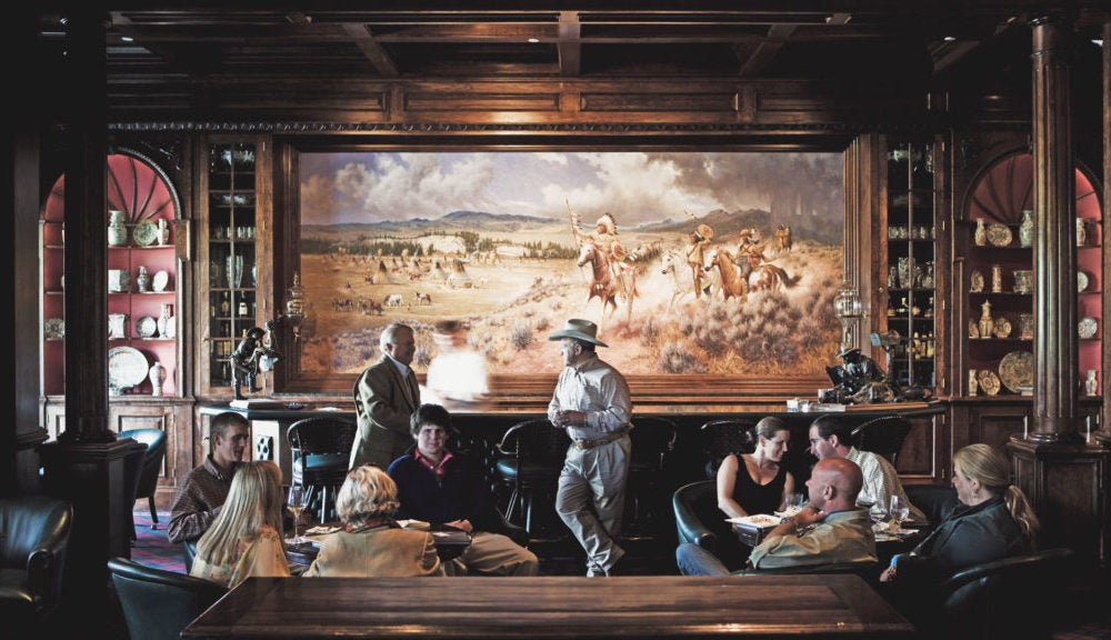 People socializing in common area of hunting lodge