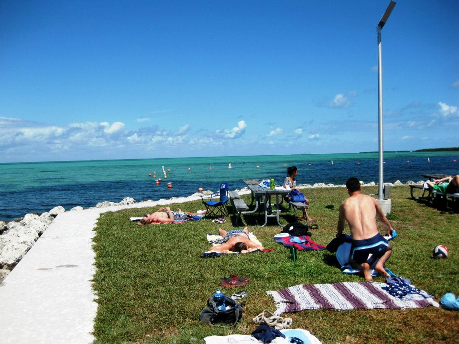 Campers soaking in the sun on the Keys coast.