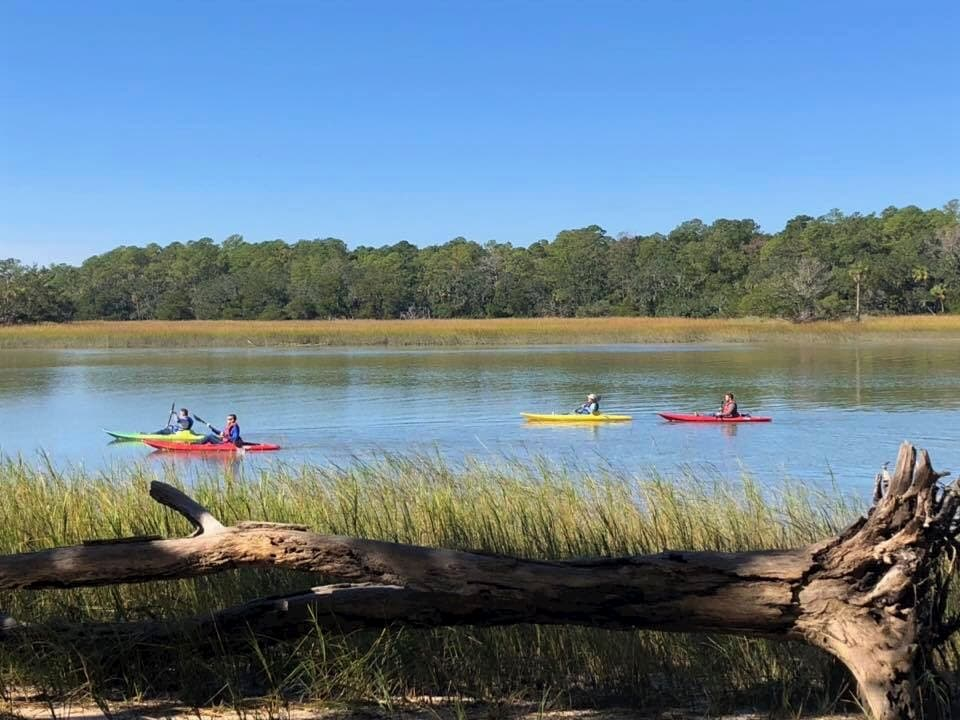 four people river kayaking at campground near savannah ga