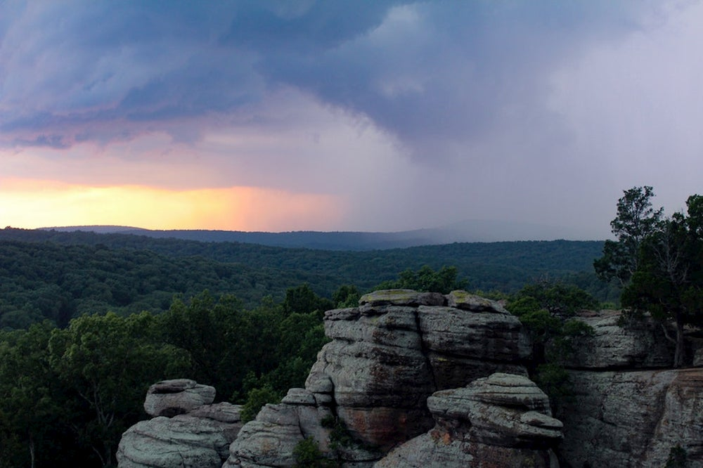 Sunset visible beneath rainclouds at Garden of the Gods in Illinois