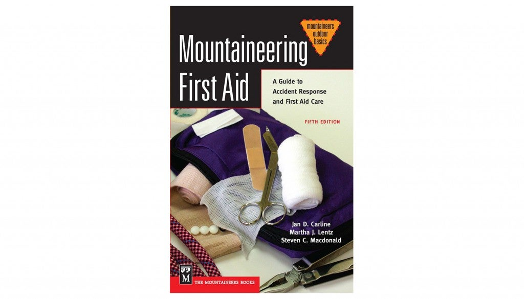 "the book cover for ""Mountaineering First Aid,"" by Jan Carline, Martha Lentz, and Steven Macdonald"