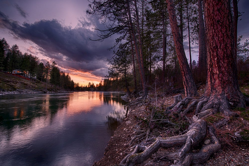 Calm waters in the Spokane River at dusk.