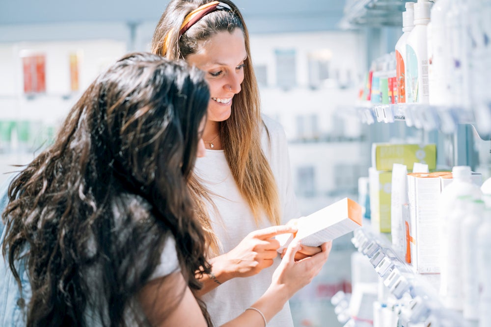 two women shopping for products in a drugstore