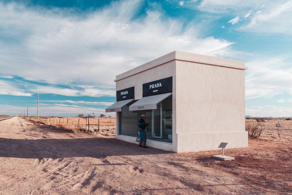 Cowboy at Prada Marfa installation in the desert.