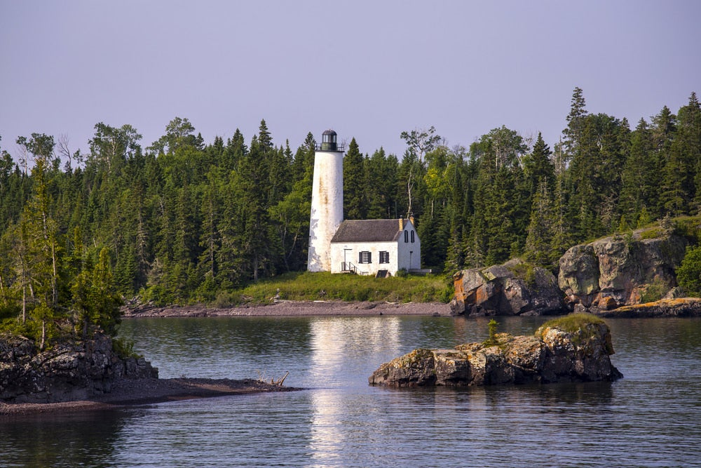 the rock harbor lighthouse on an island in lake michigan