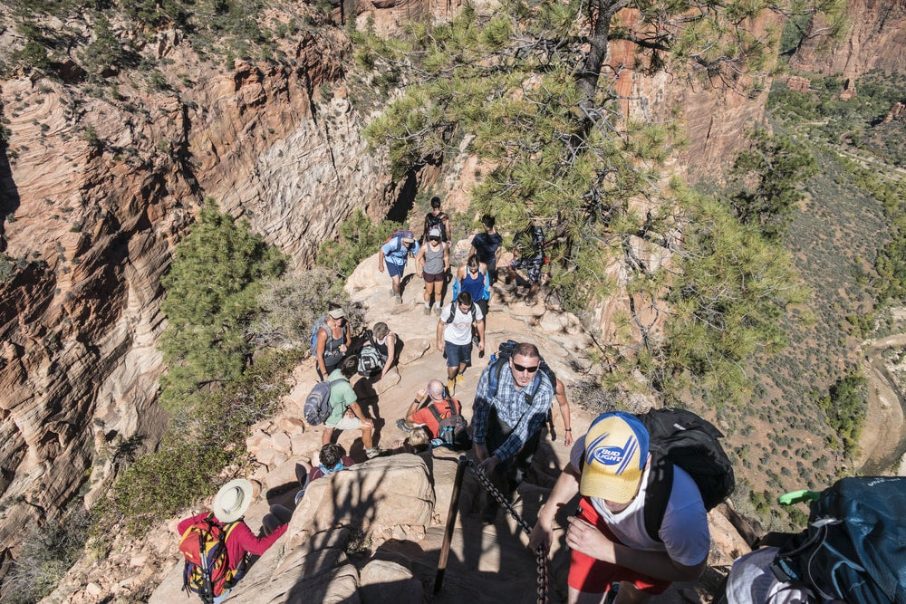 a crowd of hikers at angels landing trail in zion national park