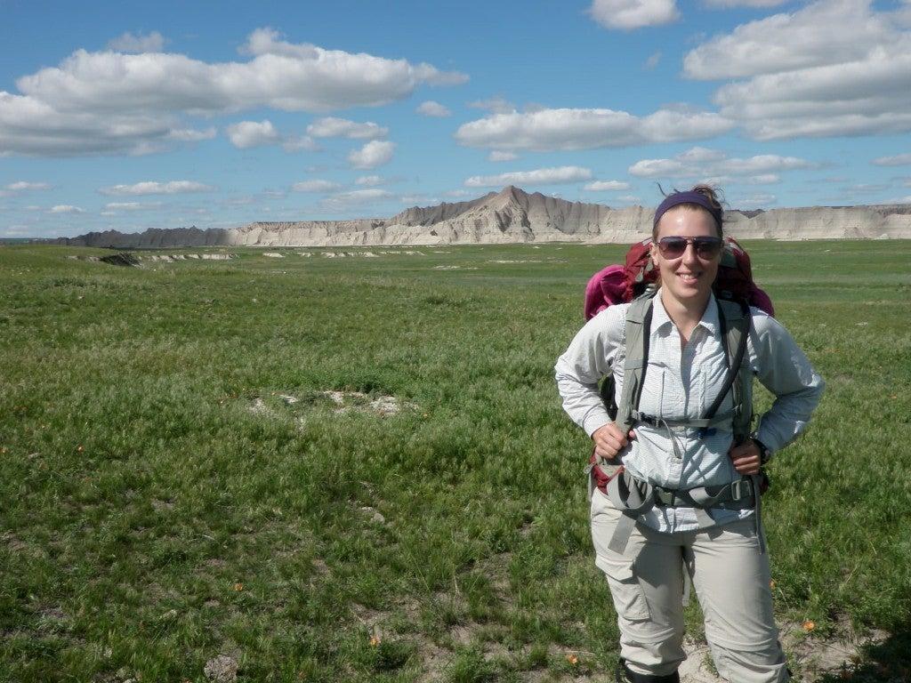 a woman researcher in a field in south dakota