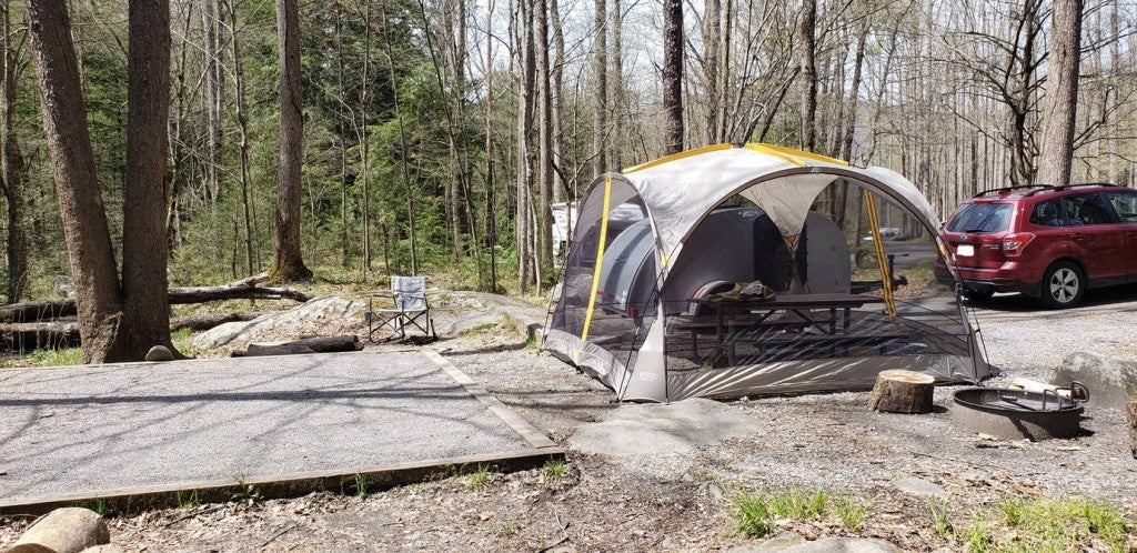 a campsite set up with a tent and a gravel pad in tennessee