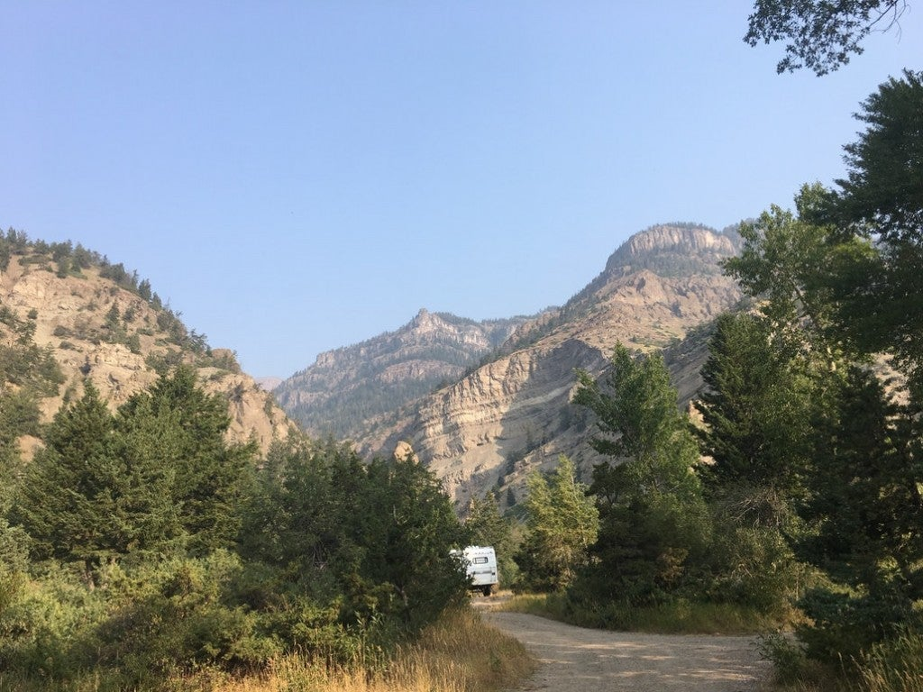 an RV parked down the road in the backcountry of wyoming's shoshone national forest