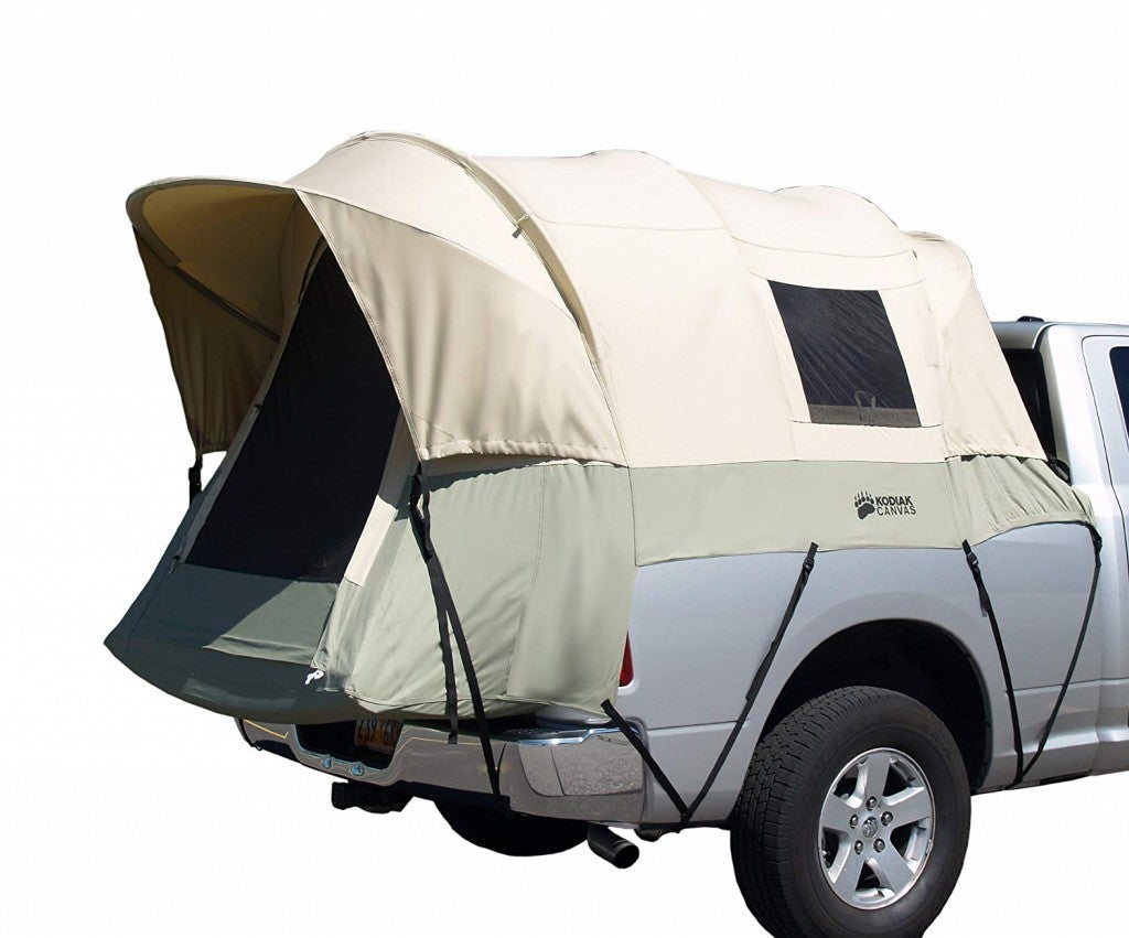 a truck bed tent attached to a car