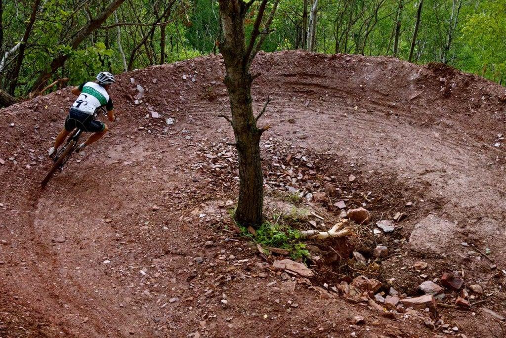 a mountain biker banks on a downhill trail near crosby, mn