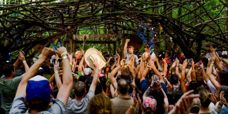 a crowd of people in front of astage at pickathon music fest