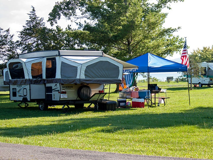 pop up trailer in campsite at button bay state park vermont